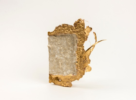 Photograph of hand made paper card with gilded edges.